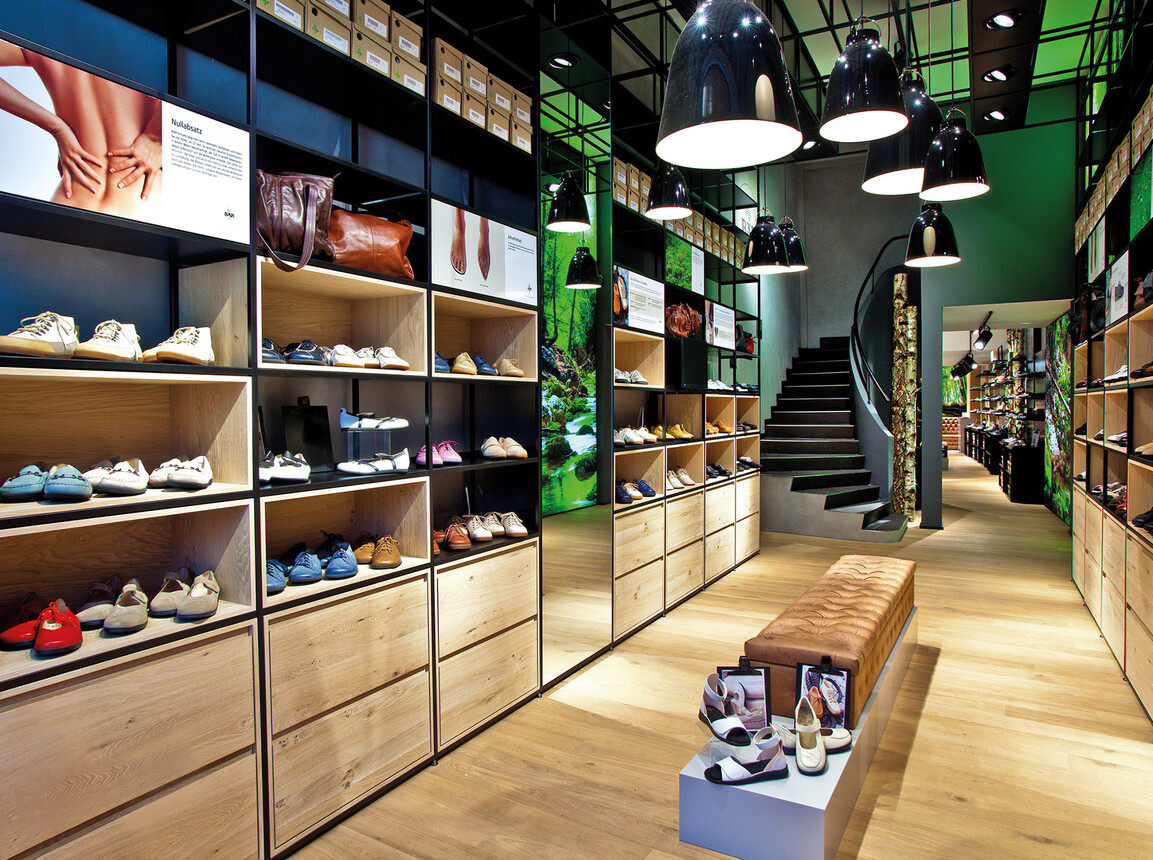 store design - shoes store - Bär Cologne - display walls - staircase