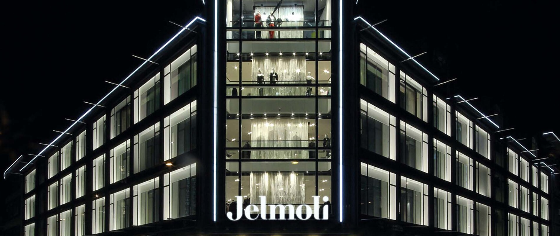 new structuring of the sales area - modern development concept - department store - Jelmoli Zurich - building facade enlighted by night