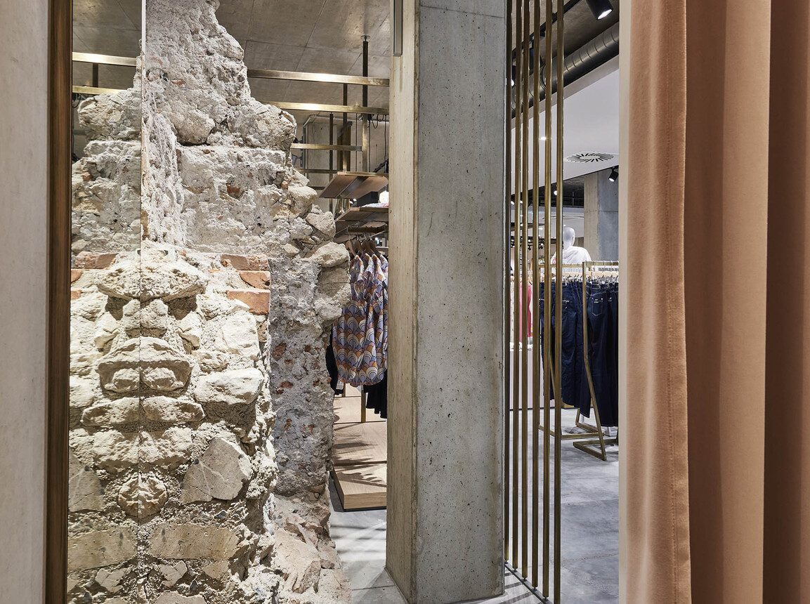 fashion store - new construction - redesign - Juhasz Bad Reichenhall - inside - interior design - old stone wall - material detail