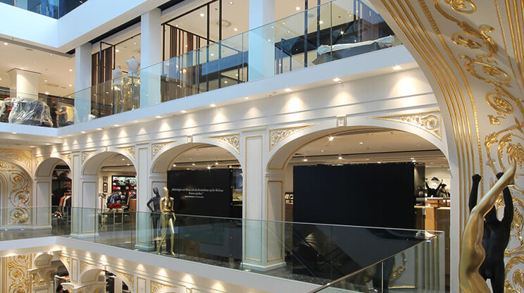 fashion department store - Redesign and new conception - expansion of retail floor space - Kastner & Öhler Graz - view into atrium - gold stucco - elegant details