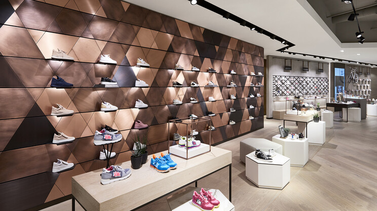 fashion house - conversion and modernisation - department store - Leffers Oldenburg - shoe department - bronze wall panels