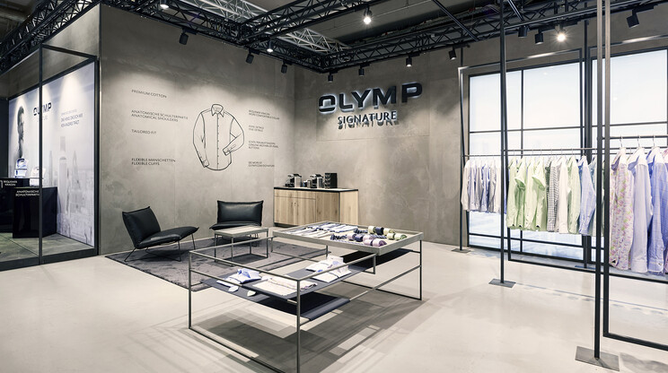 Signature fair booth - Concept und realisation - Olymp Signature Premium Berlin 2017 - view to logo wall with infographic