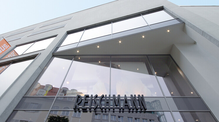 fashion store for sports and trends - reconstruction - Reischmann Sport Kempten - outside facade - entrance area - glass wall elements - logo sign