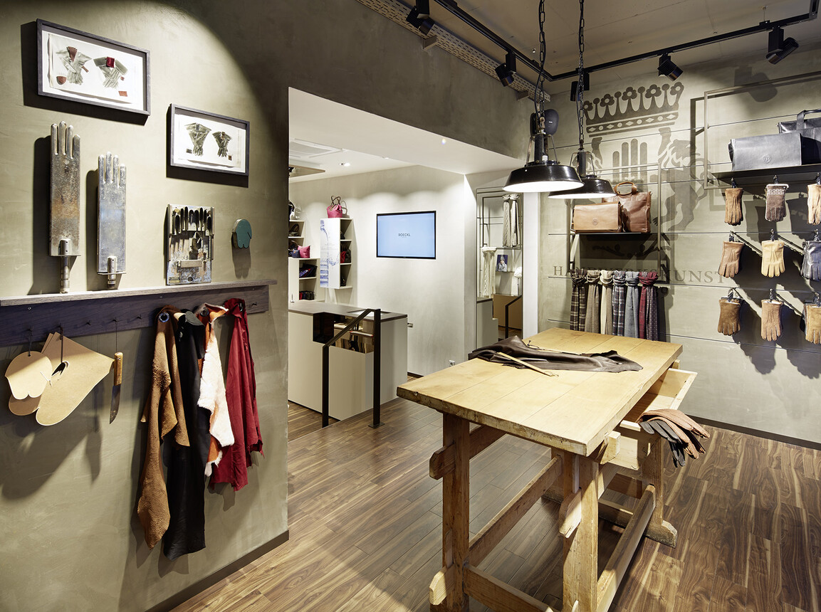 store design - retail design - Roeckl Munich - facade view from outside - manufacture table area in store