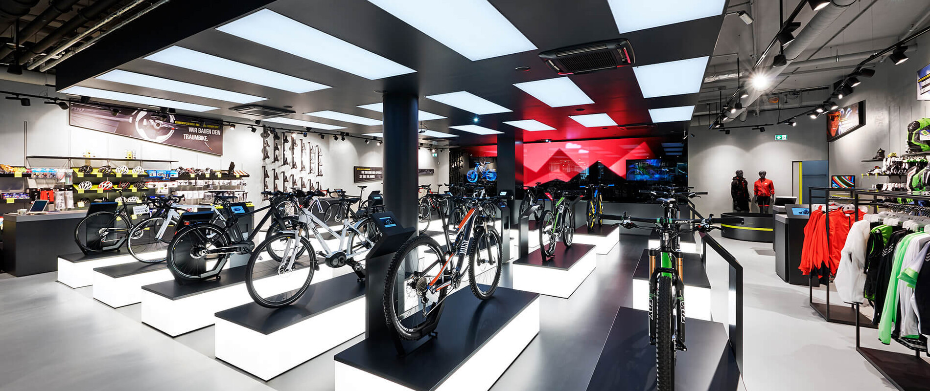 bike sports specialist store - new conception - Rose Biketown Munich - inside store overview - bike display luminescent podiums - led wall in back