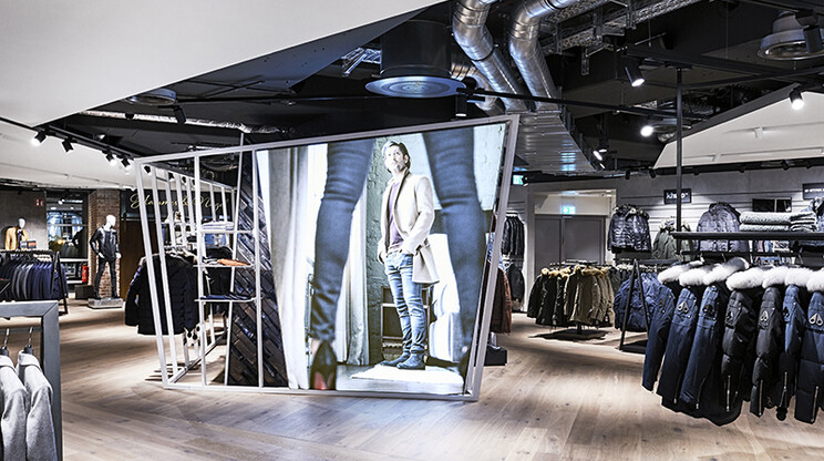Men's Fashion Store - conception - realisation - Wormland Nuremberg - store overview - central dispay area - poster wall